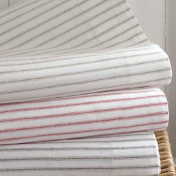 Paintbrush Ticking Flannel Bedding - To me, flannels were made for mornings in bed. These comfy pinstripe sheets from Garnet Hill are snug enough to make me want to stay all day.
