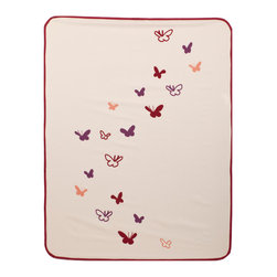 IndiB - Butterflies Stroller Blanket - IndiB is a product design venture by Indidesign based in Los Angeles, California. Led by creative director Beatrice Girelli, they design accessories, furnishings and design complements for the home, the way we like them: playful, modern and friendly. Each IndiB stroller blanket is crafted from 300 thread count cotton with contrast color border and rounded corners with a super soft 100% polyester velour backing in complementary color. Machine Washable.