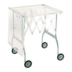 """Kartell - Battista - The multipurpose Battista features a striking design with both plastic and metal components. The top is made from high density polyurethane and the frame combines chrome-plated steel and polished aluminum. It functions as both a convenient trolley on casters and a fully functional table as well, making it equally perfect for serving appetizers and providing a surface for group activities. With tabletops as well as a sophisticated gloss lacquer top, the Battista is sure to assimilate beautifully into any surroundings. Features: -Frame made of chrome-plated steel and polished aluminum. -Top made of high density polyurethane with matte enamel or polyester lacquer. -Wheels allow for a high level of mobility. -Able to fold for compact storage. -Made in Italy. Dimensions: -Open Dimensions: 27.25"""" H x 39.38"""" W x 21.25"""" D. -Folded Dimensions: 27.25"""" H x 7.88"""" W x 21.25"""" D. Quality: -In 2005, Kartell received accreditation for its Quality Management Systems according to the ISO 9001: 2000 standard. The attainment and preservation of this certification testifies to Kartell's commitment to high quality and continued research into higher levels of quality in company management systems.. Helping the Environment: -Kartell products use a wide variety of plastic materials, thereby reducing the use of living organisms, such as trees, which are difficult and time-consuming to replace.. -Most Kartell products are easily recycled and product components can be separated to elements made of a single material to simplify the recycling process. Plastic components also carry clear identification marks to aid correct separation of different plastic types for effective recycling.. Care and Maintenance: -Kartell products are easy to clean and require only simple care to remain in excellent condition. . Order with Confidence: -Authentic Kartell products are guaranteed to be free from defects in materials and workmanship for a period of 12 months under normal use and under c"""
