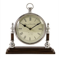 "Imax Worldwide Home - Boyleston Mantle Clock - Modern touches to this simple and sophisticated mantle clock; Country of Origin: India; Weight: 3.888 lbs; Dimensions: 9.5""h x 9""w x 3""d"