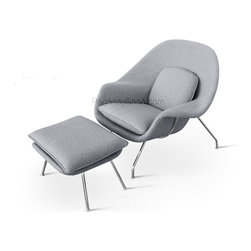 "Womb Chair & Ottoman - Light Grey - Our comfy Chair, with its matching ottoman, is a reproduction of the ""Womb chair"" designed in 1948, by Architect and Designer Eero Saarinen. The Comfy Chair comes with a steel rod base and polished-chrome finish, combined with its frame upholstered in fabric all covering a fiberglass shell. These elements highlight Saarinen's brilliant design aesthetic and his architectural skills."