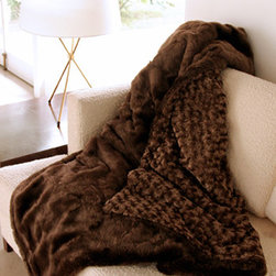 Faux-Fur Cozy Chic - What kind of ski lodge is it if there isn't a bear skin rug or faux-fur blanket for some post-slopes romance?