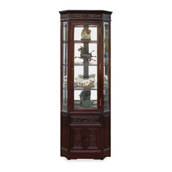 China Furniture and Arts - Rosewood Dragon Motif Corner Cabinet - Made of solid rosewood, this slim curio cabinet will exhibit your treasured collectibles with the best effect. The half-hexagon shape allows viewers to see the artwork from three sides. Museum quality lighting and mirror bring out all the details. Dragon motif, the symbol of good luck and prosperity is hand-carved on the two doors and the drawer. With this cabinet in your home, the cheerfulness is added to its surroundings. Hand applied dark cherry finish. Three adjustable glass shelves for your convenience.