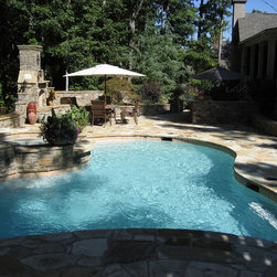 Pools - This pool is free form gunite with an elevated spa with spillway into pool, Th entertaining area includes a Fireplace, cook center, Koi Pond and waterfall, Pergola, outdoor lighting highlighting architectural features and the steps.