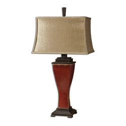 Uttermost - Abiona Distressed Red Ceramic Table Lamp - A  Carolyn  Kinder  orginial,  the  Abiona  rustic  ceramic  table  lamp  excites  any  eye  with  it's  distressed,  burnished  red  glaze  and  natural  procelain  undertones  and  bronze  metal  details.  The  rectangle  bell  shade  is  made  of  a  golden,  silkened  textile.  Click  here  to  view  our  entire  inventory  of  rustic  lamps.