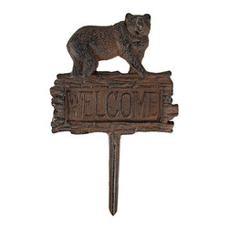 Zeckos - Antiqued Finish Black Bear Welcome Yard Stake - This cool old-fashioned cast iron black bear 'Welcome' sign is a great addition to your garden decor. Made of cast iron, the sign has a distressed brown enamel finish that gives the sign an antique, rusted look. The sign measures 6 3/4 inches tall, 7 inches wide, not including the bottom stake part, which is 5 inches long.