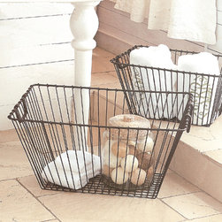 "Wire Storage Baskets - A classic rustic look combined with well-designed details make for attractive and convenient storage. These metal storage baskets are perfect for holding fruits and veggies or kitchen linens and other necessities. Fill a basket with goodies for overnight guests. Designers finished the basket in antique black to compliment any design scheme. This line features products that have been hand crafted in a variety of cottage industries around the world. Small differences in shape, size, surface, and finish should be expected and lend individuality and charm to each piece. Dimensions: (Medium) 19.5""w x 13""d x 10.5""h (Large) 25""w x 17""d x 13""h"