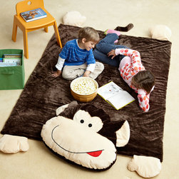 Kids Jumbo Monkey Plush Floor Mat - Are your kids like little monkeys jumping around the house? They'll love this plush jumbo monkey rug. It can act as a blanket or cushion for a twin bed as well. The mat features monkey paws, a tail and a large head that can be a pillow.