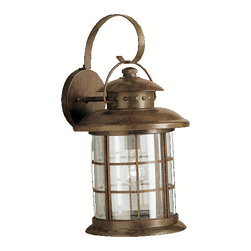 Kichler 1-Light Wall Bracket - Rustic Exterior - One Light Wall Bracket If you are looking for a new interpretation of traditional design elements, the Rustic collection is for you. This outdoor lighting line captures the look and feel of a classic, aged lantern, yet updates it for modern homes. Our rustic finish offers you the high quality construction and materials with an affordable price Kichler is synonymous for. Clear beveled glass panels complete the Rustic collection's unique lantern look making it a fantastic value for almost any home. This one light, rustic wall lantern uses a 150-watt bulb and measures 20 high. It is UL listed for wet locations.