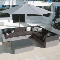 Sunday Outdoor Sectional Sofa - The Sunday outdoor wicker sectional sofa has center and corner and end sections that can create an L-shape or a straight line sofa.