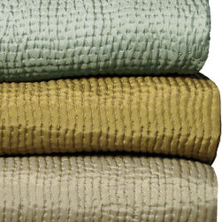 Olive King Silk Coverlet - Light scatters delicately from the refined quilted texture of the Hammered Silk Coverlet.  This king-sized version of the luxury silk bedspread is olive in color, a rich and earthy solid tone which brings natural impact to a textile pleasure inspired by French quilting.  Matching silk binds the edges of the coverlet, providing a softly-glistening stop to the small-scale stitched texture and a peerless subtlety of contrast when the blanket is turned down.