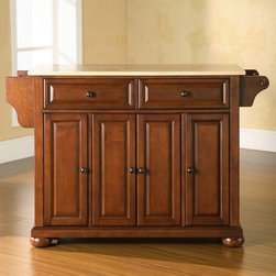 Crosley - Crosley Alexandria Natural Wood Top Kitchen Island - KF30001ABK - Shop for Bar and Pub Tables with Stools from Hayneedle.com! Elegant and charming the Alexandria Natural Wood Top Kitchen Island lets you always have a great workspace where you need it and is out of the way when you don't. Constructed of solid hardwood and wood veneers this beautiful kitchen island rolls easily on removable casters then locks in place. Remove the caster wheels if you choose a stationary look. Two deep drawers and four cabinet doors sport raised panels and a hand-rubbed multi-step finish in a variety of shades. A convenient towel bar spice rack and paper towel holder hang on the sides. Inside you'll appreciate the three large adjustable shelves. Brushed metal hardware is a quality touch. Assembles easily. It's convenient classic and creative just like your cooking. Choose from 3 elegant finish colors. Overall dimensions: 52W x 18D x 36H inches. About Crosley FurnitureIn 1920 Powel Crosley founded the company that pioneered radio broadcasting and mass market manufacturing around the world starting with a simple radio meticulously crafted with obsessive detail and accuracy and a measure of consideration for the wallet. These high ideals have served the company well for over 90 years and they live on in the newest addition to the family. Crosley Furniture sets a new standard for innovation function and meticulous craftsmanship in the manufacture of value-priced furniture. They proudly offer durable furniture products featuring hardwood and veneer construction with rich multi-step finishes in a multitude of styles.