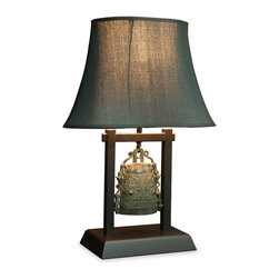 China Furniture and Arts - Bronze Bell Table Lamp with Shade - Magnificently hand-forged and richly cast with decorative ornament, this lamp takes its shape from an ancient bronze bell reminiscing traditional Shang Dynasty (1066 B.C.) aesthetic. A wooden base is specially made to complement this work of art. Topped with a smoke black linen shade. 75 watt max.