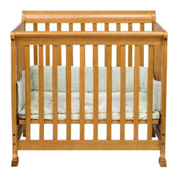 Da Vinci - DaVinci Kalani Convertible Mini Wood Crib in Honey Oak Finish - Da Vinci - Cribs - M5598O - Kalani is cool and confident. It's DaVinci at its best. With first class engineering the Kalani Mini Crib gives baby years of sweet serenity in a smaller package. In one simple conversion this mini crib becomes a twin bed for when baby's all grown up. It's Cool. It's Kalani.