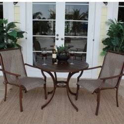 "Hospitality Rattan Chub Cay Slatted Patio Dining Bistro Set - Dark Bronze - If you enjoy alfresco meals with a loved one, the Hospitality Rattan Chub Cay Slatted Patio Dining Bistro Set - Dark Bronze will be a big hit with you. With a simple, yet elegant look that effortlessly blends classic style and contemporary aesthetics, this bistro set, which includes two arm chairs and a 36-inch diam. table with slatted aluminum top, is sure to complement in any outdoor setting.Boasting a tubular extruded bamboo-look aluminum frame in a unique powder coated dark bronze finish that will not rust, the arm chairs feature exclusive, custom-made Twitchell sling fabric, which is so comfy that it eliminates the need for cushions, seating you in luxurious comfort throughout your meal. The bistro table features a no-glass, slatted aluminum table top that prevents water accumulation and offers plenty of space for two or more table settings. With the pieces being weather- and UV-resistant, you are assured of years of enjoyment, while the stackable design of the arm chairs makes off-season storage a breeze.Dimensions:Arm chair (each): 23W x 32D x 37H inchesBistro table: 36 diam. x 29H inchesAbout Hospitality RattanHospitality Rattan has been a leading manufacturer and distributor of contract quality rattan, wicker, and bamboo furnishings since 2000. The company's product lines have become dominant in the Casual Rattan, Wicker, and Outdoor Markets because of their quality construction, variety, and attractive design. Designed for buyers who appreciate upscale furniture with a tropical feel, Hospitality Rattan offers a range of indoor and outdoor collections featuring all-aluminum frames woven with Viro or Rehau synthetic wicker fiber that will not fade or crack when subjected to the elements. Hospitality Rattan furniture is manufactured to hospitality specifications and quality standards, which exceed the standards for residential use.Hospitality Rattan's Environmental CommitmentHospitality Rattan is continually looking for ways to limit the impact on the environment and is always trying to use the most environmentally friendly manufacturing techniques and materials possible. The company manufactures the highest quality furniture following sound and responsible environmental policies, with minimum impact on natural resources. Hospitality Rattan is also committed to achieving environmental best practices throughout its activity whenever this is practical and takes responsibility for the development and implementation of environmental best practices throughout all operations. Hospitality Rattan maintains a policy of continuous environmental improvement and therefore is a continuing work in progress.Hospitality Rattan's Environmentally Friendly Manufacturing ProcessAll of Hospitality Rattan products are green. From its basic raw materials of rattan poles, peels, leather, bamboo, abaca, lampacanay, wood, leather strips, and boards, down to other materials like nails, staples, water-based adhesives, finishes, stains, glazes and packing materials, all have minimum impact to the environment and are safe, biodegradable, recycled, and mostly recyclable. Aside from this, the products have undergone an environmentally-friendly process that makes them """"greener."""" The company's rattan components are sourced from sustained-yield managed forests, which means that the methods used to grow and harvest the rattan vines ensure the long-term life of the forest and protect the biodiversity of the forest's ecosystems.Hospitality Rattan is committed to buying and using all materials, from rattan and hardwood to finishing materials, from reputable and renewable suppliers and seeks appropriate evidence that suppliers are in compliance with this policy. Hospitality Rattan strives to use materials that are processed in an environmentally responsible manner, or consist of a high level of recycled material. Finishing materials and stains used in Hospitality Rattan's furniture products consist of 75% water-based solutions which evaporate upon application with reduced or Volatile Organic Compounds (VOCs). The furniture factories use water-based glues, stains, topcoats and other finishes on all of their products. The switch from traditional solvent-based processes to water-based processes involved consolidating several processes by the factories, resulting in an 85% reduction in VOC emissions."