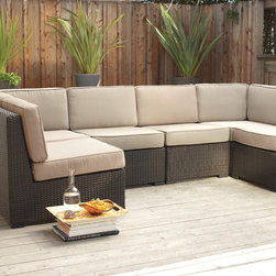 Filum Modular Sectional - Create a unique lounging space outdoors with our new Filum armless sectional.  On the deck or patio, or under the shade trees, it's modular design will fit your space perfectly.  In a dark brown resin wicker with an aluminum frame.  Sorry not available in IL or MN.
