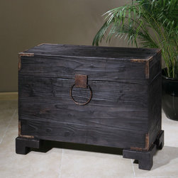 None - Carino Hardwood Trunk Table - The fascinating Carino trunk table is a stunning addition to your home furnishings. The impressive piece features black satin, solid fir wood with natural knots, and deep grains with copper brown metal accents.