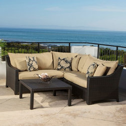 RST Brands - RST Brands Delano 4 Piece Corner Sectional Sofa and Coffee Table Set Multicolor - Shop for Tables and Chairs Sets from Hayneedle.com! Relax in the outdoors with friends and family with the RST Outdoor Delano 4 Piece Corner Sectional Sofa and Coffee Table Set a stylish and comfortable outdoor seating set that's constructed with hand woven rich espresso colored polyethylene wicker. Made of 100% recycleable materials the set's PE wicker is cool to the touch and retains its deep luster no matter how long it has been exposed the harsh rays of the sun. The framework is made of textured bronze color powder-coated aluminum and crafted to withstand the most extreme weather conditions. It's also engineered to withstand sea-salt and chlorinated environments.The outdoor corner sectional is made up of one 48 inch left arm seating component and one 48 inch right arm seating component that attaches to a 36 inch square corner section. Seating components are 31 inches deep from front to back; seating area is 24 inches deep. A matching coffee table measures 33 inches square by 16 inches high. The coffee table requires minor assembly.SolarFast outdoor fabric is engineered to be long lasting fade-resistant and durable. It also allows the fabric to retain color and vibrancy and is designed to be fast drying to avoid mildewing. The set is easy to clean with mild soap and water.About Red Star TradersSince 2004 Red Star Traders LLC (made up of RST Outdoor RST Living and FlowWall System) has designed and manufactured products in the outdoor living home decor and wall-based organizational products categories. Red Star is a direct import product marketing company. Red Star categories of focus include jewelry boxes men's gifts & furnishings and RTA furniture. Their team of marketing and design professionals can help identify market trends and deliver products that meet target retails with maximum perceived value. Red Star's network of manufacturing partners and overseas production managers insure integrity in production and strict quality control.