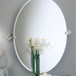 Latitude II Brass Oval Tilting Mirror - With its contemporary and minimalist design, this oval tilting mirror will give your bathroom a crisp, clean appearance. Tilts up and down for your pampering needs. Comes with solid forged brass mounting hardware.