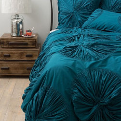 Lanna Duvet Cover, Turquoise - Anthropologie has some of the most gorgeous, textured bedding pieces I've ever seen. Throw in a vibrant color like this aquamarine blue, and you can bet you'll sleep soundly every night.
