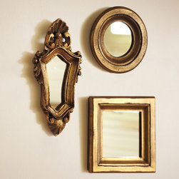 Mini Gilded Gold Mirrors - Create an instant collection with these mirrors, a glam addition to any entry or hallway. I love the idea of these mixed with faded and crackled antique mirrors.