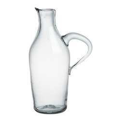 Miguel Wine Carafe - Rustic, chunky pitcher is handcrafted of recycled glass with an organic shape, freeform curved handle and smooth scissor-cut rim.
