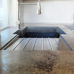 Drainboard - Integrated drainboard is stylish and functional. Stainless steel rods protect the concrete and add interest. Photo by Kingbird.