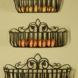 Tuscan Iron Hand-forged Metal Planters/Shelves - Am I suggesting you store fruit in your baby's room? No, I'm suggesting you think out of the box! For a cool and unique look, use wall-mounted planters to store baby items. Buy them in different sizes to create a tapered effect (like the one pictured), or buy a bunch of the same size and get creative with how to fill the space on your walls.