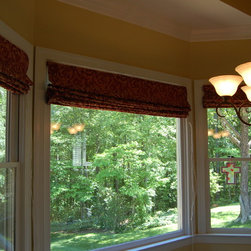 Flat Roman Shades in Bay Window - Flat Roman shades custom made for the clients 3 kitchen windows.