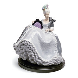 """Lladro Porcelain - Lladro Rococo Lady At The Ball Figurine - Plus One Year Accidental Breakage Repl - """" This piece depicts a very womanly, sensuous and self-confident lady in a baroque language, eschewing other more languid or modest representations. These are hedonistic pieces reflecting the joie de vivre of these women, their carefree attitude to life, removed from all worldly problems, and with a very strong personality. While unmistakably baroque, they possess an undeniably modern look. This lady, with saturated and strong colours so particular as purple or black, represents the night and makes a couple with Rococo lady on swing (01008424), which symbolizes the day .  Hand Made In Valencia Spain - Sculpted By: Alfredo Llorens - Included with this sculpture is replacement insurance against accidental breakage. The replacement insurance is valid for one year from the date of purchase and covers 100% of the cost to replace this sculpture (shipping not included). However once the sculpture retires or is no longer being made, the breakage coverage ends as the piece can no longer be replaced. """""""