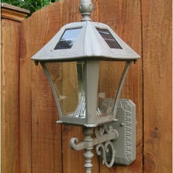 Gama Sonic Baytown Solar Wall Mount Lamp - With gorgeous, traditional style and solar-powered efficiency, the Gama Sonic Baytown Solar Wall Mount Lamp is a perfect replacement for your energy-guzzling outdoor lighting. This lamp can be mounted on a pillar, fence, or exterior wall, and will provide brilliant, bright light all night long. It automatically turns on at dusk and off at dawn for worry-free operation, and its rust-resistant frame and finish keep maintenance at a minimum.Additional Features:Rust-resistant finish for durabilityAutomatic on at dusk, off at dawnIncludes Li-Ion rechargeable batteriesCone reflector provides brightest light possibleAbout Gama SonicEstablished in 1985 as a manufacturing and marketing company of emergency lights and other electronic products, Gama Sonic main goal is to provide the most innovative designs at a reasonable price. Gama Sonic has focused on the solar lighting market since 2001, and has become a leading company in the field of solar charged and rechargeable lights. Gama Sonic produces a wide range of products, which incorporate plastics, stainless steel, electronics, and OEM products in various markets around the world. Their ability to transform an idea into a complete product designed for consumer needs is intertwined with their commitment to high-quality standards. Gama Sonic has even ventured into the idea of free, green lighting for lamp posts using solar power, and they are very excited to fill the market's need for this concept. The unique designs available, light output, and installation options are second to none worldwide.