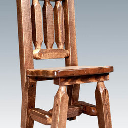"Montana Woodworks - Homestead Child's Chair, Stained and Lacquered - From Montana Woodworks, the largest manufacturer of handcrafted, heirloom quality rustic furnishings in America comes the Homestead Collection line of furniture products. Handcrafted in the mountains of Montana using solid, American grown wood, the artisans rough saw all the timbers and accessory trim pieces for a look uniquely reminiscent of the timber-framed homes once found on the American frontier. Give your child the gift of a lifetime. He or she is sure to pass this extraordinary little chair onto other generations, creating a treasured family heirloom. Seat height is 12"". Comes fully assembled. 20-year limited warranty included at no additional charge. Hand Crafted in Montana U.S.A.; Solid, U.S. grown wood; Timbers and Trim Pieces are Sawn Square for Rustic Timber Frame Design Appearance; Heirloom Quality; 20 Year Limited Warranty; Durable Build, Fit and Finish; Each Piece Signed By The Artisan Who Makes It; Solid genuine lodge pole pine; Finally a Chair Made for the Younger Friends and Family. Dimensions: 13""W x 14""D x 26""H"
