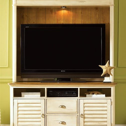Liberty Furniture - Ocean Isle Entertainment Center - Wire management provisions. Warranty: One year. Made from hardwood solids and New Zealand pine veneers. Bisque with natural pine finishHutch:. Lighted hutch. TV space: 55 in. W x 38 in. H. Overall: 64 in. W x 13 in. D x 52 in. H (143 lbs.)TV stand:. Three media bays. Boxed drawer construction. Metal drawer glides. Felt lined drawers. English dovetail construction. Satin nickel knob and cup hardware. One adjustable shelf behind doors. Complete dust proofing. Media bay: 18 in. W x 19 in. D x 5.5 in. H. Overall: 63 in. W x 21 in. D x 32 in. H (224 lbs.)