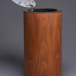 """Launch"" Walnut Clothing Hamper - Cylindrical wood enclosure with exotic  veneer,perforated, brushed aluminum lid opens 155 degrees for ease of accessibility to the removable catch bag. Mounted on casters for mobility. Available in 16"" or 18"" diameters."