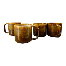 Caramel Mugs - Set of 4 - Sold in sets of 4. This rich, cozy mug has a beautiful glaze of browns and golds. They just belong next to a fireplace! A warm and soothing way to enjoy your morning coffee or bed time tea. The modern shape feels great in the hand and they stack nicely in the cabinet.