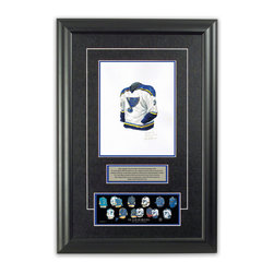 """Heritage Sports Art - Original art of the NHL 2001-02 St. Louis Blues jersey - This beautifully framed piece features an original piece of watercolor artwork glass-framed in an attractive two inch wide black resin frame with a double mat. The outer dimensions of the framed piece are approximately 17"""" wide x 24.5"""" high, although the exact size will vary according to the size of the original piece of art. At the core of the framed piece is the actual piece of original artwork as painted by the artist on textured 100% rag, water-marked watercolor paper. In many cases the original artwork has handwritten notes in pencil from the artist. Simply put, this is beautiful, one-of-a-kind artwork. The outer mat is a rich textured black acid-free mat with a decorative inset white v-groove, while the inner mat is a complimentary colored acid-free mat reflecting one of the team's primary colors. The image of this framed piece shows the mat color that we use (Medium Blue). Beneath the artwork is a silver plate with black text describing the original artwork. The text for this piece will read: This original, one-of-a-kind watercolor painting of the 2001-02 St. Louis Blues jersey is the original artwork that was used in the creation of this St. Louis Blues uniform evolution print and tens of thousands of other St. Louis Blues products that have been sold across North America. This original piece of art was painted by artist Nola McConnan for Maple Leaf Productions Ltd. Beneath the silver plate is a 3"""" x 9"""" reproduction of a well known, best-selling print that celebrates the history of the team. The print beautifully illustrates the chronological evolution of the team's uniform and shows you how the original art was used in the creation of this print. If you look closely, you will see that the print features the actual artwork being offered for sale. The piece is framed with an extremely high quality framing glass. We have used this glass style for many years with excellent results. W"""