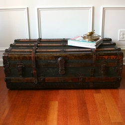 Antique Steamer Trunk Coffee Table by Rhapsody Attic - This is industrial home decor with antique refinement. These stately trunks with leather, metal and wood accents work with just about every interior.