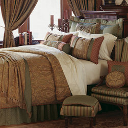 "Frontgate - Glenwood Comforter - Super Queen, Hand Tacked - From Eastern Accents. Button-tufted and hand-tacked comforters have two layers of decorative fabric with polyester batting secured inside to prevent shifting. Twin - 63"" x 88"" Queen - 88"" x 90"" Super Queen - 96"" x 98"" King - 102"" x 90"" Super King - 114"" x 98"" California King - 104"" x 100"".. Dry clean only recommended. Because this bedding is specially made to order, please allow 4-6 weeks for delivery.. A true classic, the Glenwood Bedding Collection is rich in traditional hues and adornments. The duvet cover, in a grand ruby and olive design pairs with mitered and gimped shams in deep sage with intricate insert styling. The collection's accessories are generously ornamented in fringed edges and decorative tassels, making this an ensemble to behold.  .  .  .  . . Made in USA of imported goods. Part of the Glenwood Bedding Collection."