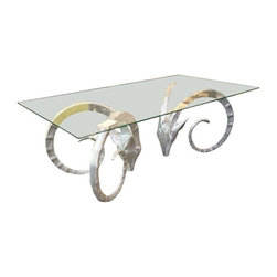 Used Solid Aluminum Ibex Coffee Table - Make a rambunctious statement with this very striking and shapely coffee table. The base is made of solid aluminum and comes in quite the unusual form of 2 ibex heads! You won't need much else for that wow factor in whatever room this resides.