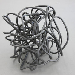 Untitled, 2011 by Thór Vigfússon - This abstract aluminum sculpture by Thor Vigfusson showcases the artist's experiments with geometric abstraction. The artist has twisted aluminum wire into a serpentine tangle that plays with negative space. Here, Vigfusson ventures into three dimensions, a bold departure from his signature translucent wall pieces.