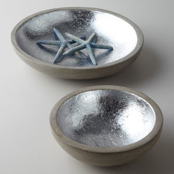 "Gaby - Gaby Two ""Augustine"" Bowls - An unexpected mix of rough exterior and gleaming interior, these bowls feature a unique, natural concrete texture that accentuates any tabletop, shelf, or console. Made of lava stone with silver-leaf interior. Set of two includes one 8""Dia. x 2.5""T bo..."