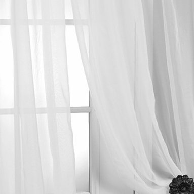 Solid White Voile Poly Sheer Curtain - These beautiful and classic solid voile poly sheer curtain panels come two in the set for extra value. These sheer panels are unmatched in quality and design. They create a warm atmosphere with beautiful light diffusion.