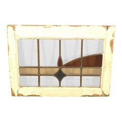 Antiques - Antique English Lead Glazed Stained Glass Window - This is a beautiful antique English lead glazed stained glass window. It has a traditional wooden frame and it features a beautiful *astragal lead glazed textured stained glass window with a distinguished design.  It may show minor age appropriate signs of wear including wood imperfectionsbut as shown it is overall in very good cosmetic and structural condition.What is astragal (wood or lead) glazing?  As it pertains to later period furniture, it is a method of securing glass to the straight, semi-circular, or shaped moldings found on glass doors and windows of furniture. On newer reproduction furniture, the astragal molding may set atop the glass to give the appearance of glazing where on older English furniture, it is not uncommon for each piece of glass to be cut to shape and glazed into the molding.Other Dimensions (In inches)Glass 11H x 17.5WFrame 1.75W