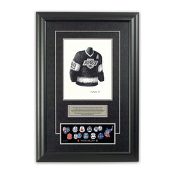 "Heritage Sports Art - Original art of the NHL 1988-89 Wayne Gretzky jersey - This beautifully framed piece features an original piece of watercolor artwork glass-framed in an attractive two inch wide black resin frame with a double mat. The outer dimensions of the framed piece are approximately 17"" wide x 24.5"" high, although the exact size will vary according to the size of the original piece of art. At the core of the framed piece is the actual piece of original artwork as painted by the artist on textured 100% rag, water-marked watercolor paper. In many cases the original artwork has handwritten notes in pencil from the artist. Simply put, this is beautiful, one-of-a-kind artwork. The outer mat is a rich textured black acid-free mat with a decorative inset white v-groove, while the inner mat is a complimentary colored acid-free mat reflecting one of the team's primary colors. The image of this framed piece shows the mat color that we use (Silver). Beneath the artwork is a silver plate with black text describing the original artwork. The text for this piece will read: This original, one-of-a-kind watercolor painting of Wayne Gretzky's 1988-89 Los Angeles Kings jersey is the original artwork that was used in the creation of this Wayne Gretzky jersey evolution print and tens of thousands of Wayne Gretzky products that have been sold across North America. This original piece of art was painted by artist Tino Paolini for Maple Leaf Productions Ltd. Beneath the silver plate is a 3"" x 9"" reproduction of a well known, best-selling print that celebrates Wayne Gretzky's hockey history. The print beautifully illustrates a chronological evolution of some of Wayne Gretzky's jerseys and shows you how the original art was used in the creation of this print. If you look closely, you will see that the print features the actual artwork being offered for sale. The piece is framed with an extremely high quality framing glass. We have used this glass style for many years with excellent results. We package every piece very carefully in a double layer of bubble wrap and a rigid double-wall cardboard package to avoid breakage at any point during the shipping process, but if damage does occur, we will gladly repair, replace or refund. Please note that all of our products come with a 90 day 100% satisfaction guarantee. Each framed piece also comes with a two page letter signed by Scott Sillcox describing the history behind the art. If there was an extra-special story about your piece of art, that story will be included in the letter. When you receive your framed piece, you should find the letter lightly attached to the front of the framed piece. If you have any questions, at any time, about the actual artwork or about any of the artist's handwritten notes on the artwork, I would love to tell you about them. After placing your order, please click the ""Contact Seller"" button to message me and I will tell you everything I can about your original piece of art. The artists and I spent well over ten years of our lives creating these pieces of original artwork, and in many cases there are stories I can tell you about your actual piece of artwork that might add an extra element of interest in your one-of-a-kind purchase."