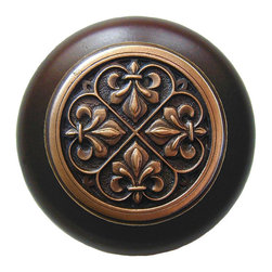 "Inviting Home - Fleur-de-Lis Walnut Wood Knob (antique copper) - Fleur-de-Lis Walnut Wood Knob with hand-cast antique copper insert; 1-1/2"" diameter Product Specification: Made in the USA. Fine-art foundry hand-pours and hand finished hardware knobs and pulls using Old World methods. Lifetime guaranteed against flaws in craftsmanship. Exceptional clarity of details and depth of relief. All knobs and pulls are hand cast from solid fine pewter or solid bronze. The term antique refers to special methods of treating metal so there is contrast between relief and recessed areas. Knobs and Pulls are lacquered to protect the finish. Alternate finishes are available. Detailed Description: The Fleur-de-lis means ""flower of the lily"" It was used to represent French royalty. It was said that the king of France Clovis who started using the symbol of the Fleur-de-lis because the water lilies helped guide him to safety and aided him in winning a battle. The design in the Fleur-de-Lis pulls is arranged in alternating positions of the Fleur-de-lis. These pulls are a great match for the Fleur-de-lis knobs which have the Fleur-de-lis pattern arranged in a circle. The different shapes of decorative hardware make the cabinet doors and drawers interesting to look at."