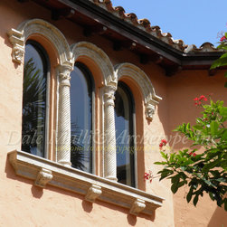 Archetype Inc/ Weston, Florida/ 954 646 3931 - Arched Window Moldings, Columns & Sills - Three Arched Stone Window Moldings with Fluted Stone Pilaster Columns, Stone Window Sills with Acanthus Leaf Corbels..