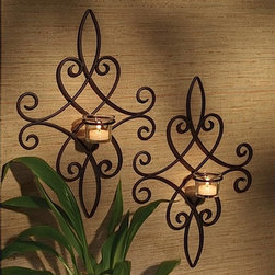 Brocade Candle Wall Sconces (Set of 2) - This pair of iron wall sconces can be displayed at graduated heights or side-by-side. Their rich rustic finish will compliment almost any home design.