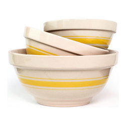 Yellow Three-piece Mixing Bowl Set - A set of white and yellow striped nesting bowls could be used for baking, as display or for housing fresh fruit from the farmer's market.