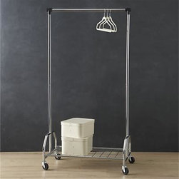 Extra Large Rolling Clothes Rack - Generous rolling rack features an extendable clothes hanging rod and lower wire shelf for storing extra shoes, luggage and accessories, or expanded coat storage for entertaining.