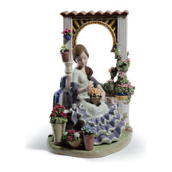 """Lladro Porcelain - Lladro Andalusian Spring Figurine - Plus One Year Accidental Breakage Replacemen - """" With a notable Spanish flavor, the composition of this piece is reminiscent of the brands hugely successful floral pieces. It is worth highlighting that there are the 6 different varieties of flowers (roses, carnations, geraniums and other spring flowers), arranged in 6 different pots as well as the rose bush climbing up the walls and the arch. In addition to the plants and flowers, always present in the courtyards of houses in Andalusia, there are other elements that help to place this scene in the typical courtyard, or patio as it is known in the south of Spain. The most striking is definitely the Arabic-style arch, evocative of the Alhambra in Granada or the Mosque in Cordoba. Another original detail are the tiles, decorated following the traditional style of this region. A piece full of details, a cat asleep on the bench, the flounces and polka dots of the girls dress, so characteristic of the south of Spain, not to mention the shawl with its three large roses (visible when looking through the window). Hand Made In Valencia Spain - Sculpted By: Jose Santaeulalia - Limited To: 2000 Pieces Worldwide - Included with this sculpture is replacement insurance against accidental breakage. The replacement insurance is valid for one year from the date of purchase and covers 100% of the cost to replace this sculpture (shipping not included). However once the sculpture retires or is no longer being made, the breakage coverage ends as the piece can no longer be replaced. """""""